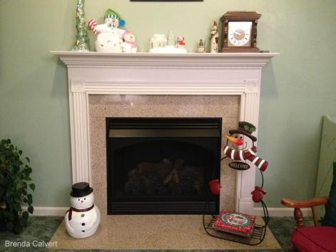 BRENDA'S SNOWMAN AT FIREPLACE w. credits