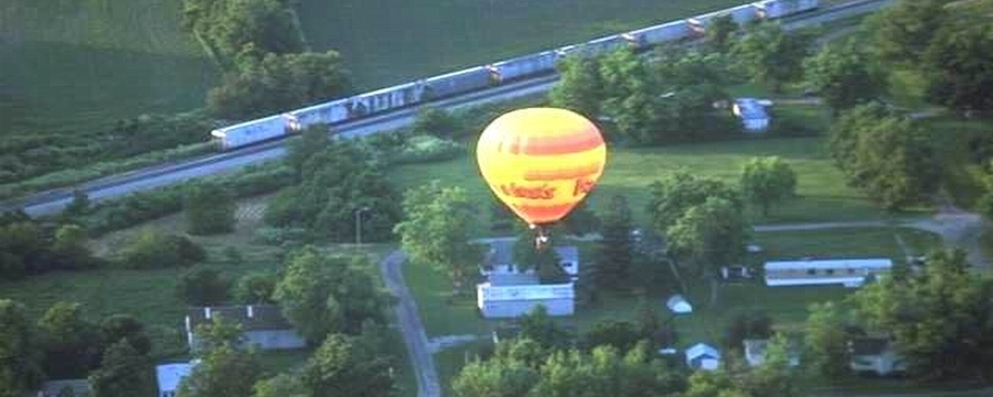 balloon-over-village-w-train-enlarged-as-whole.jpg