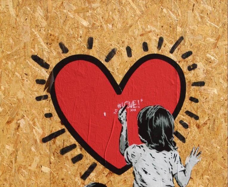 GIRL DRAWING HEART ON WALL - cropped -- SFerrario - PX