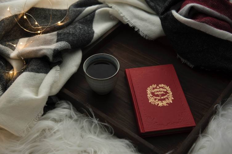 CHRISTMAS CAROL BOOK & COFFEE - Photo by Joanna Kosinska on Unsplash